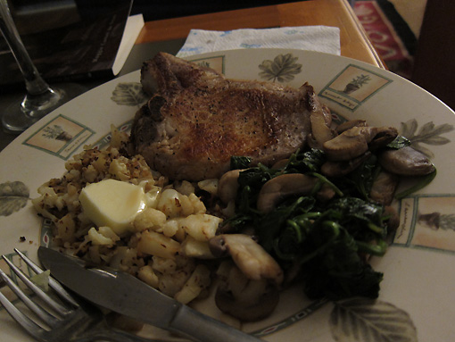 Pork chops, browned cauliflower, spinach and mushrooms