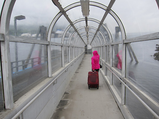 Walking to the ferry with my new pink raincoat!