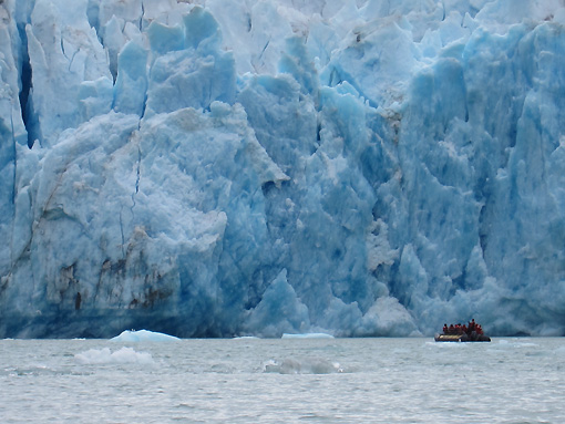 Look how tiny our dinghy looks against the glacier!