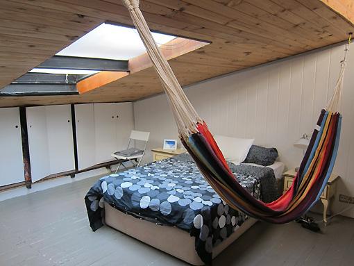 Loft bedroom (yes, that is a hammock!)